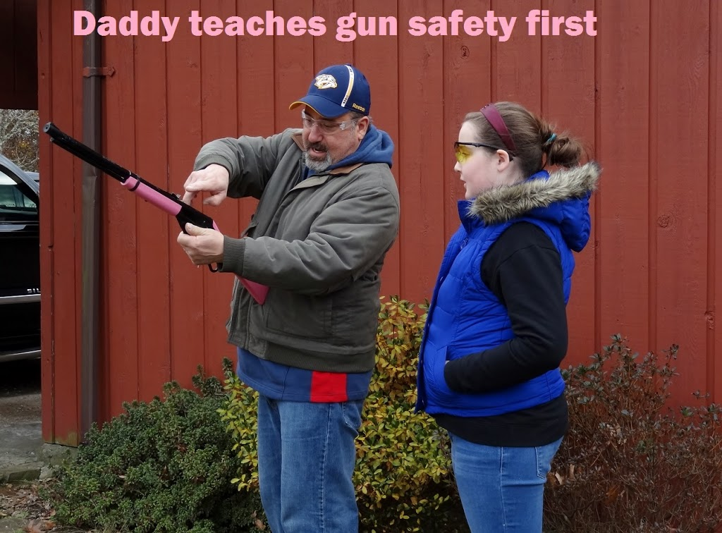 Daddy teaches gun safety