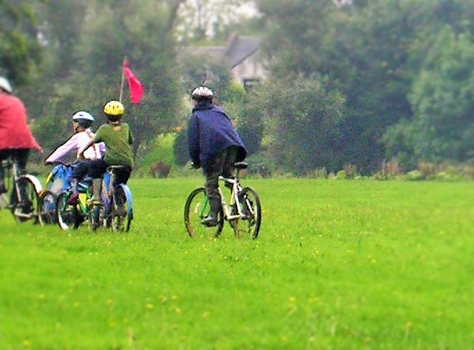 Active family on bikes - How To Keep Your Family Active on a Budget