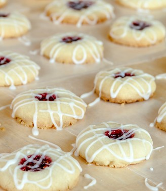 Easy Raspberry Jam Thumbprint Cookies With Powdered Sugar Drizzle