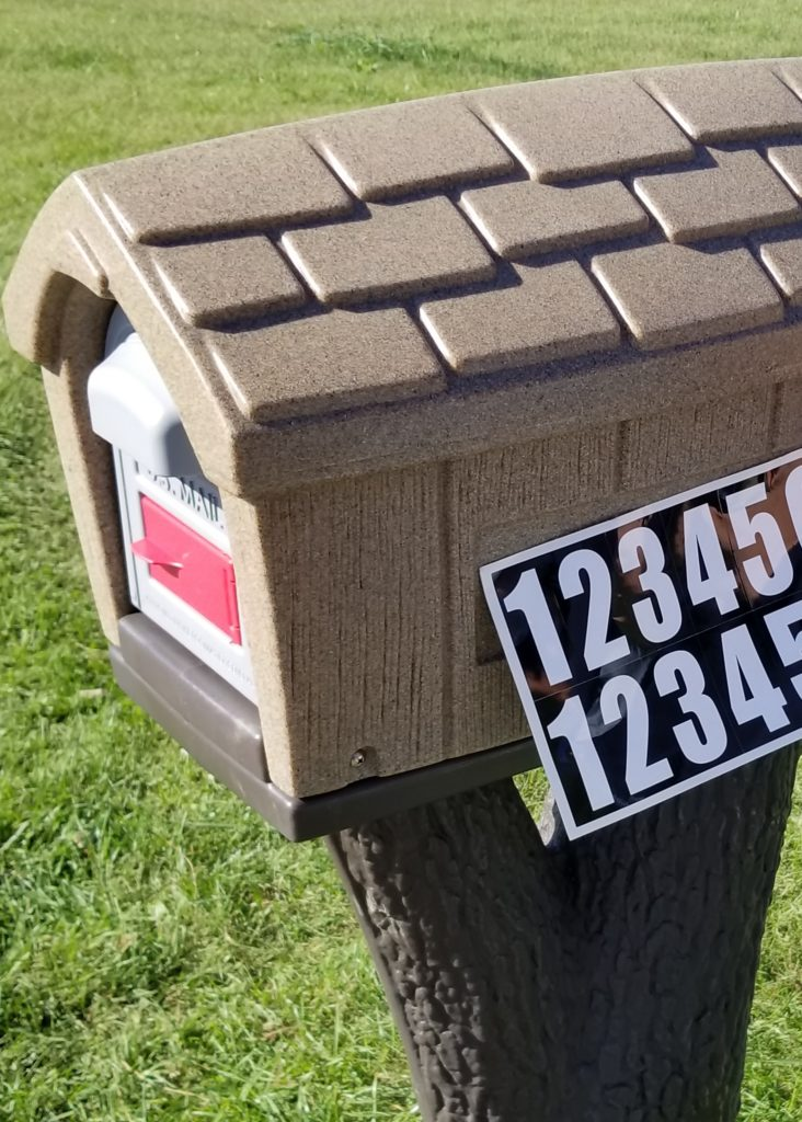 Add Country Charm to Your Driveway with a Rustic Mailbox